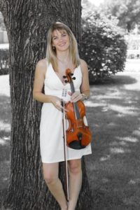 Ashley Rescot in white with acoustic violin